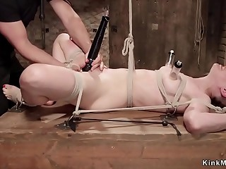 Redhead in doggy bondage anal toyed