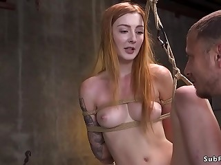 Redhead in bondage caned and banged