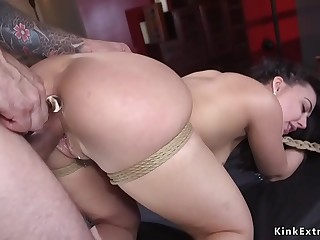 Brunette slut in bondage double penetration banged