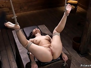 Hogtied brunette gets slapped in basement