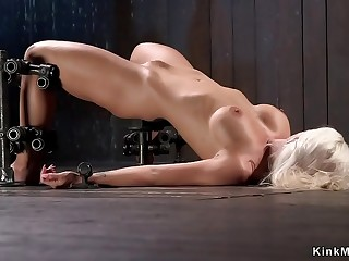 Waxed blonde whipped in tool bondage