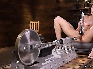 Tied up spreaded brunette fucks machine