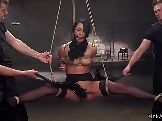 Gagged brunette fucked in bondage threesome