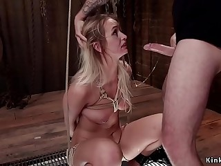 Blonde in rope bondage sitting on Sybian