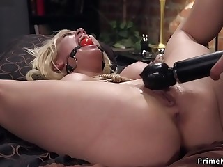 Busty blonde doggy banged in bondage