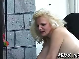 Voracious lady is cuddling her huge boobs