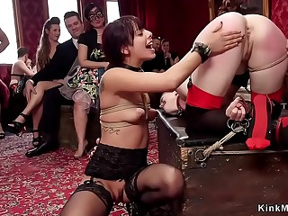 Tied up slaves sucking big cock at orgy