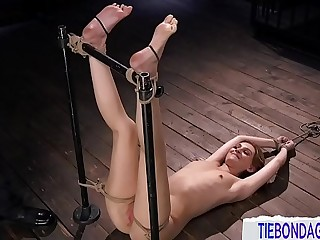 Young BDSM slave bound and punished