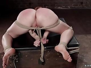 Gagged redhead slave suffers bondage