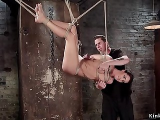 Sexy brunette takes hogtie suspension