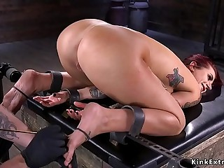 Busty redhead gets pussy lips tormented