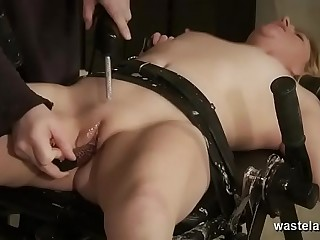 Enslaved Brunette Rigidly Bound With Hard Leather Straps To An Iron Table And Dominated Electrically